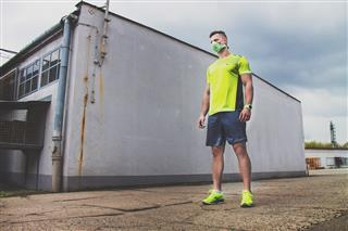 man running sport near building