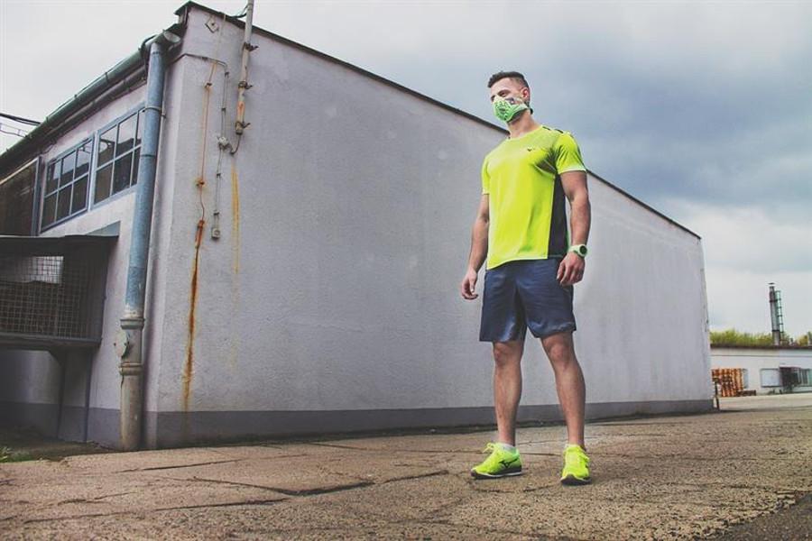 man running sport near building